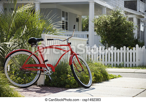 Red bicycle in front of house. - csp1492383