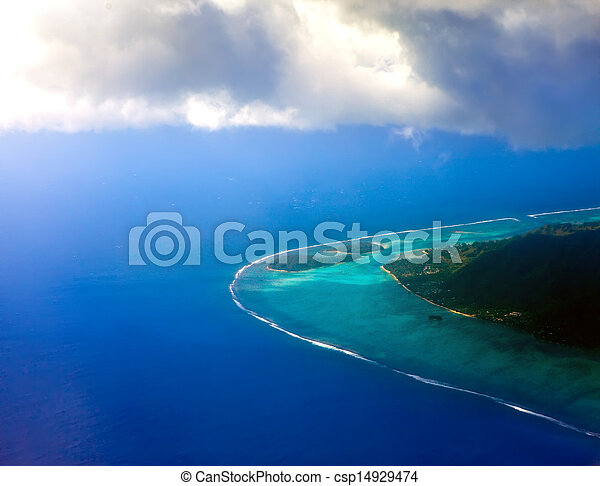 Polynesia. The atoll in ocean through clouds. Aerial view - csp14929474