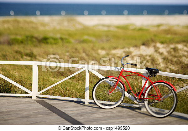Red beach cruiser bicycle. - csp1493520