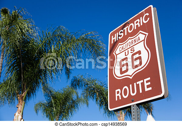 Historic route 66 highway sign with palm tree and a blue sky - csp14938569