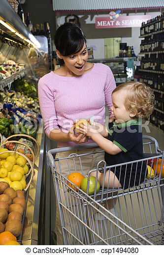 Mother grocery shopping with toddler. - csp1494080