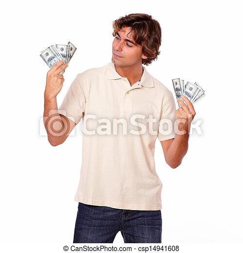 Charismatic fashionable man holding cash money - csp14941608