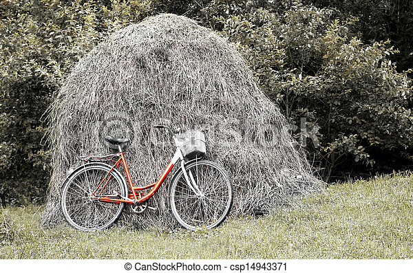 Bike stands against a haystack. Rural landscape - csp14943371