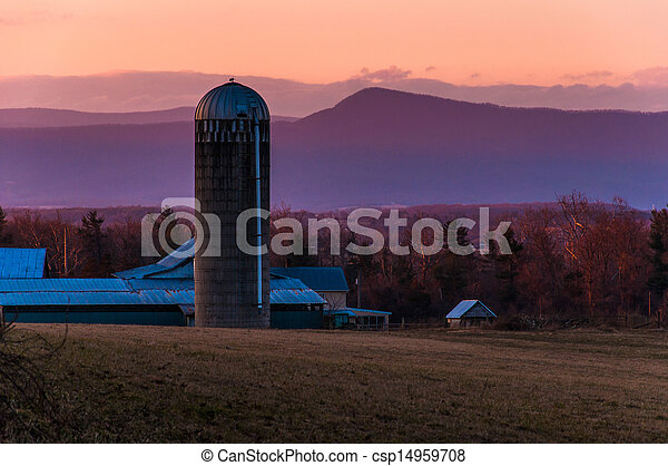 Barn and silo on a farm in the Shenandoah Valley at sunset, with Massanutten Mountain behind, near Luray, Virginia - csp14959708