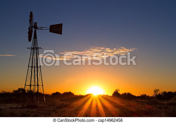 Lovely sunset in Kalahari with windmill and grass - csp14962456