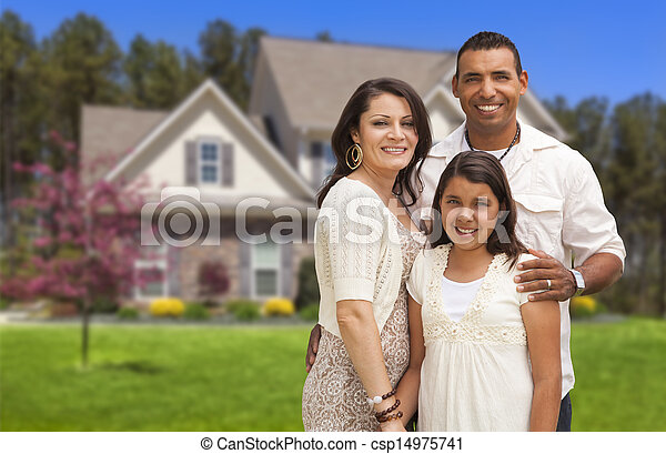Small Hispanic Family in Front of Their Home - csp14975741