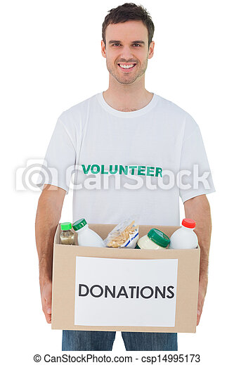 Handsome man carrying donation box with food - csp14995173