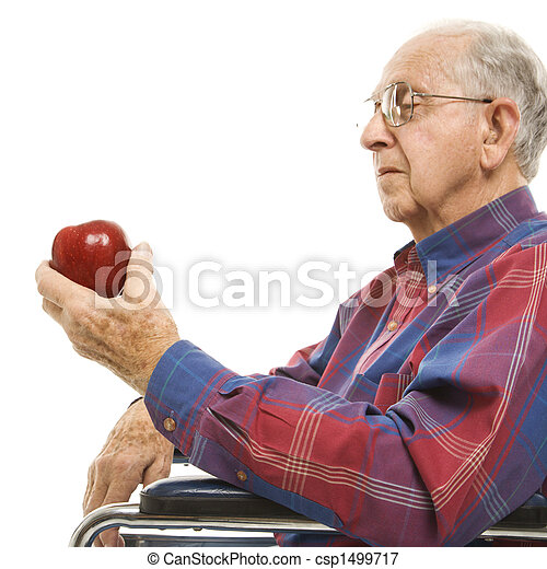 Elderly man holding apple. - csp1499717