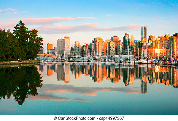 Beautiful view of Vancouver skyline with Stanley Park at sunset - csp14997367