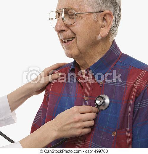 Man having physical exam. - csp1499760. Mid-adult Caucasian female hands ...