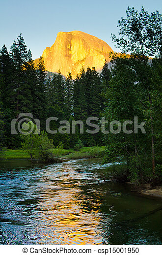 The warm glow of Half Dome's face during sunset at Yosemite National Park. - csp15001950