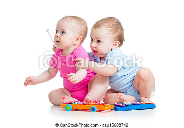Little children girl and boy play musical toys. Isolated on white background - csp15008742