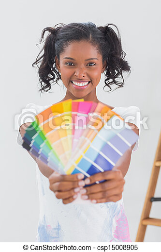 Excited woman showing colour charts - csp15008905