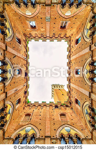 Siena landmark photo. Cortile del Podesta courtyard, Torre del Mangia tower and Palazzo Pubblico building. Bottom view. Tuscany, Italy - csp15012015