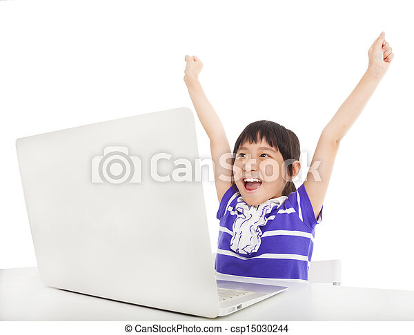 happy little girl learning computer in the classroom - csp15030244