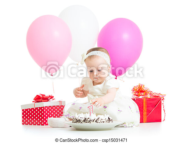 baby girl touching light on birthday cake - csp15031471