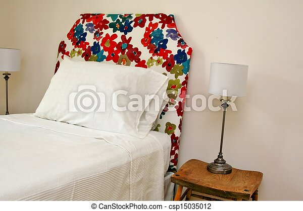 Colorful headboard with lamps