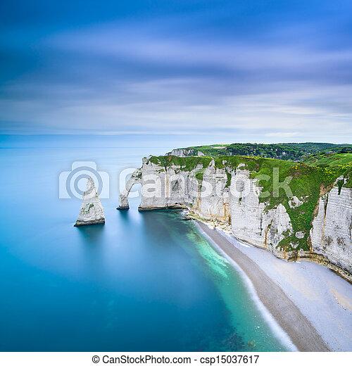 Etretat Aval cliff and rocks landmark and ocean . Normandy, France. - csp15037617