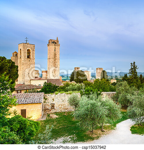 San Gimignano landmark medieval town on sunset, towers and park. Tuscany, Italy - csp15037942