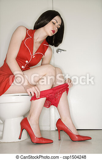 Woman sitting on toilet. - csp1504248