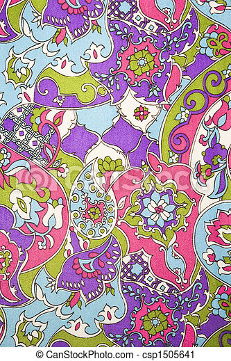 Close-up of colorful vintage fabric with flowers and shapes printed on polyester.