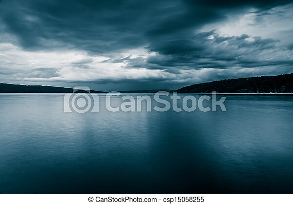 Dark storm clouds over Cayuga Lake, in Ithaca, New York. - csp15058255