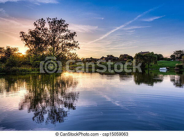 Sunset on the lake - csp15059063