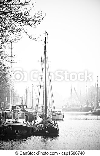 Ships with reflection in port- black and white image