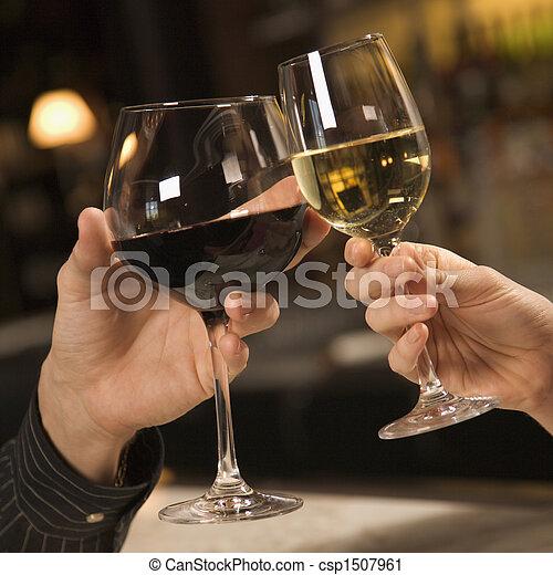 Hands toasting wine. - csp1507961