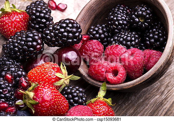 tasty summer fruits on a wooden table - csp15093681