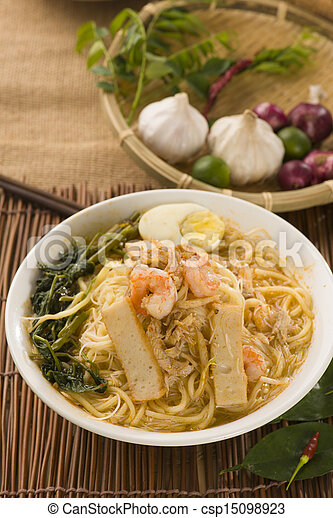 Prawn mee, prawn noodles. Famous Malaysian food spicy fresh cooked har mee in clay pot with hot steam.