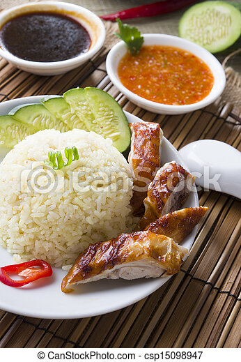 singapore chicken rice , traditional singaporean food with items as background   - csp15098947