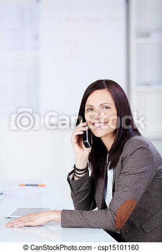Woman on cellular phone - csp15101160