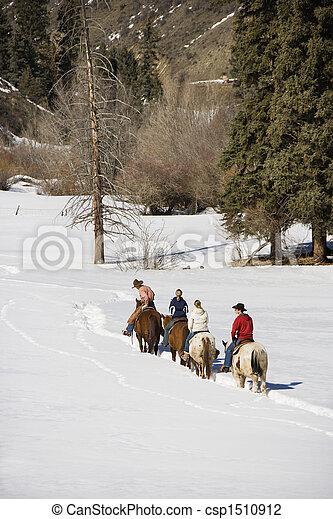 Group horseback riding in snow. - csp1510912