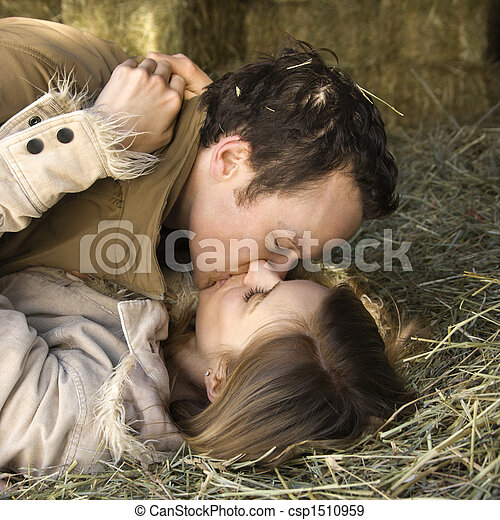 Kissing couple in hay. - csp1510959