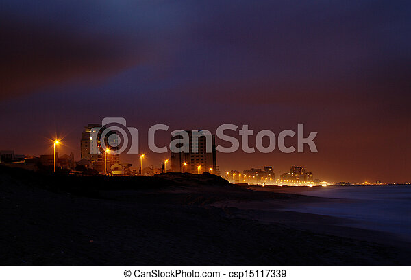 City by the sea at night