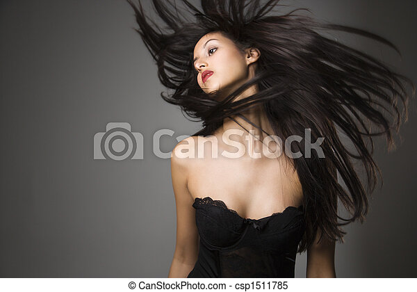 Woman flinging long hair. - csp1511785