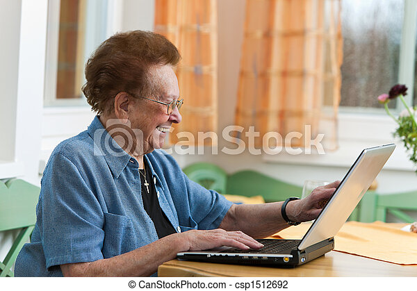 Active senior with a laptop in Leisure - csp1512692