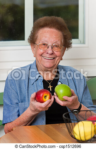 Senior with fruit for vitamins - csp1512696