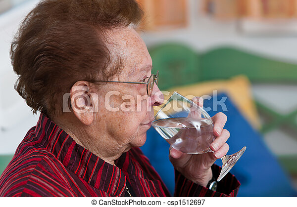 Senior drinking water from a glass - csp1512697