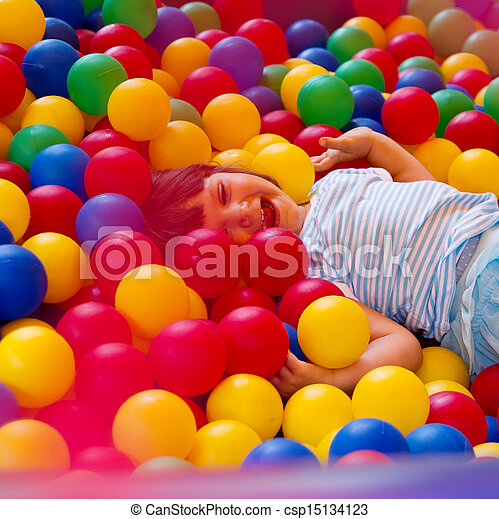 Little girl playing in inflatable bouncing castle - csp15134123