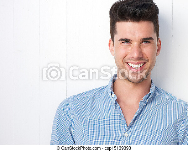 Portrait of a happy young man smiling - csp15139393