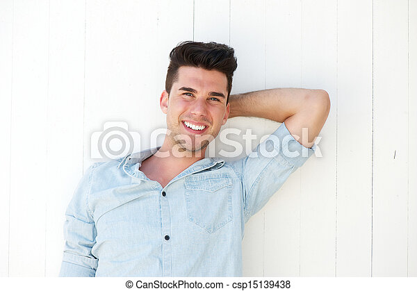 Good looking young man laughing outdoors