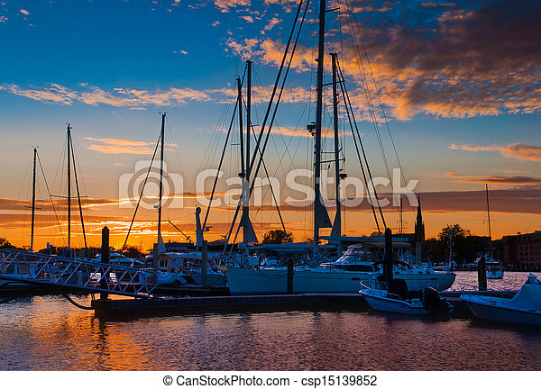 Sunset over boats in a marina in Annapolis, Maryland.  - csp15139852