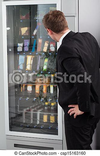 Man pointing towards window display - csp15163160