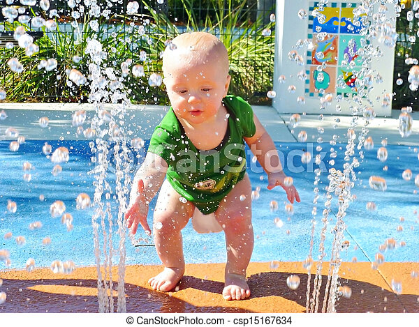 Baby Playing in Water Fountain - csp15167634