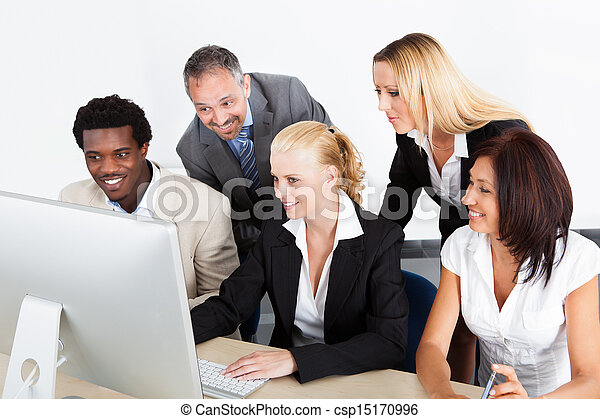Group Of Businesspeople Looking At Computer - csp15170996