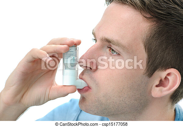 Young man using an asthma inhaler - csp15177058