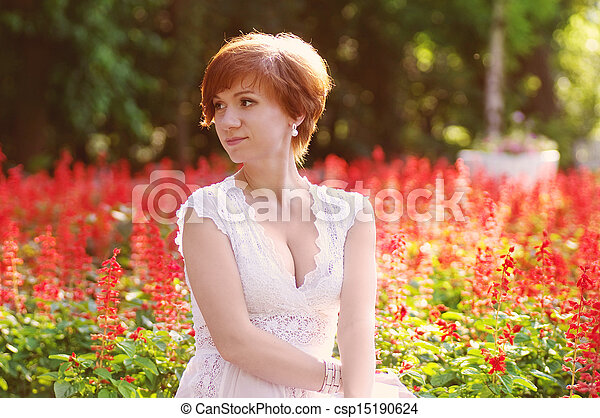 Stock photo of pregnant woman in green garden beautiful for Gardening while pregnant