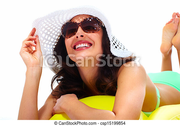 Woman wearing sunglasses and a hat. - csp15199854